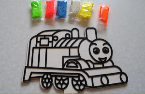 Train with colored clay by fingers
